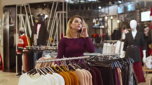Thumbnail for Young Woman Talk on the Phone Agressively and Loudly in the Store