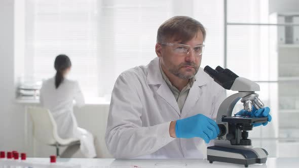 Thumbnail for Male Biomedical Scientist Posing for Camera