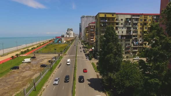 Cover Image for Cars Running Down Seafront Boulevard in Batumi Georgia, Black Sea Resort City