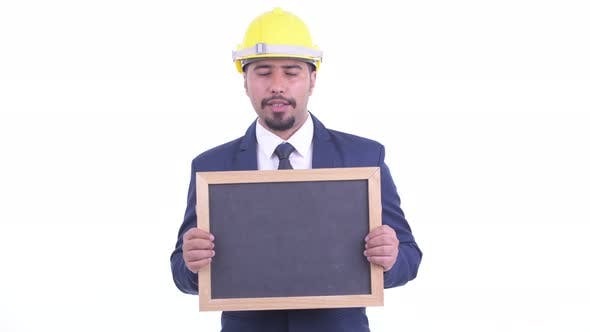 Thumbnail for Happy Bearded Persian Businessman As Engineer Talking While Holding Blackboard