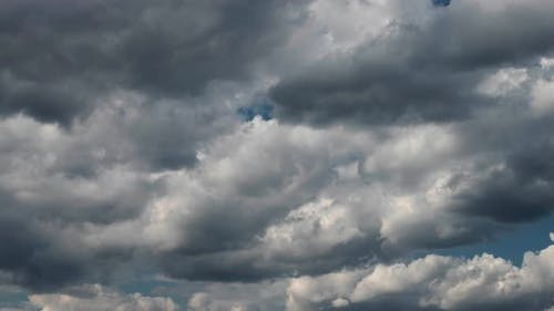 Sky time lapse with moving turbulent clouds on blue sky.