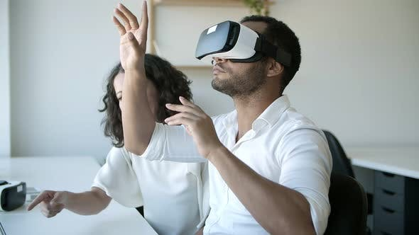 Thumbnail for Slow Motion of Cheerful Workers Testing VR Headset