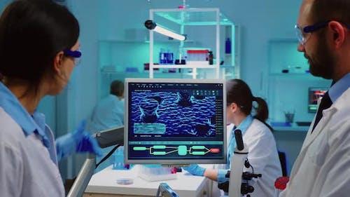 Professional Chemists Analysing Vaccine Development