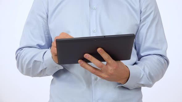 Thumbnail for A Man Works on a Tablet - Front Closeup - White Screen Studio