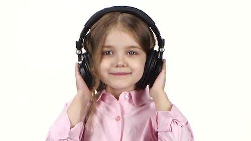 Little Girl Listens Music on Headphones and Dances, Close Ups