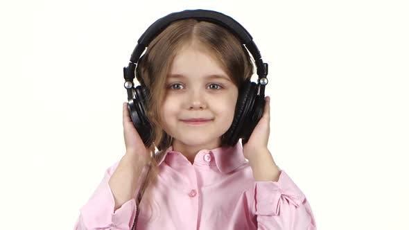 Thumbnail for Little Girl Listens Music on Headphones and Dances, Close Ups