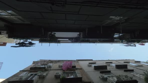 A bottom view of a narrow street