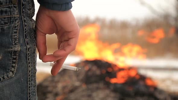 Thumbnail for Farmer Burning Stack of Dry Reed