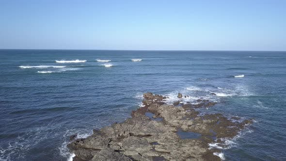 Thumbnail for Drone Flying Backwards Pacific Ocean Empty Blue Water Waves No People