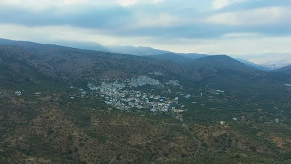 Flying Over a Small Greek Village. View From Above on the Landscapes of Greece, Crete. The Concept