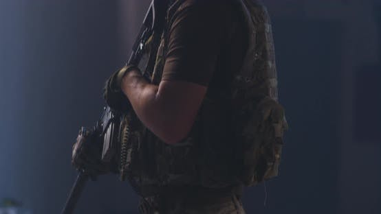 Thumbnail for Military Man Aiming Gun in Dark Hallway