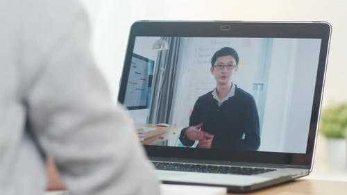 Young Asia teen girl university student using laptop computer distance learn lesson.