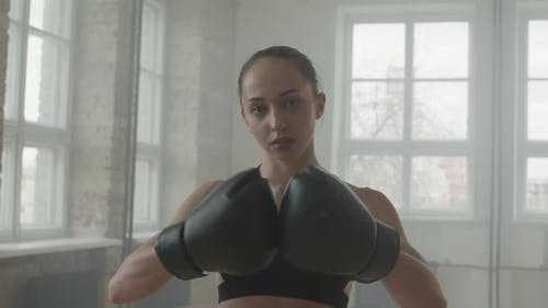 Portrait Of Attractive Female Boxer In Gloves