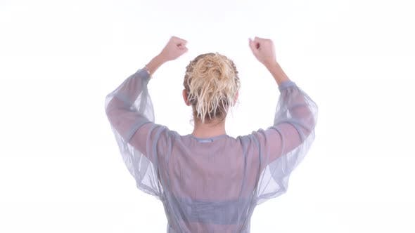 Thumbnail for Rear View of Happy Blonde Woman with Fists Raised