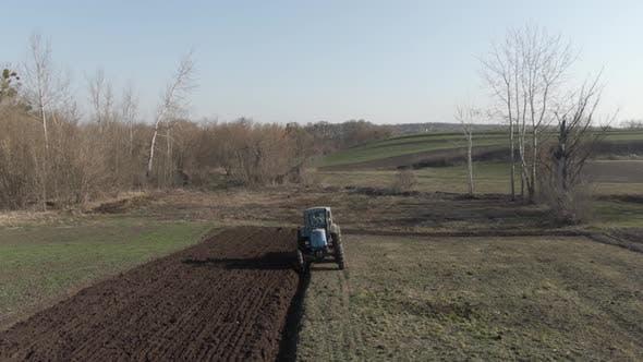 Thumbnail for Camera Follows Tractor Furrowing Fertile Field