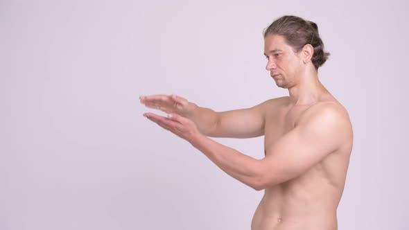 Cover Image for Happy Muscular Shirtless Man Snapping Fingers and Showing Something