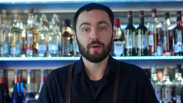 Thumbnail for Positive Bartender Talking To a Camera at a Bar Counter