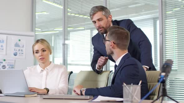 Cover Image for Executive Discussing Work with Businesspeople during Meeting