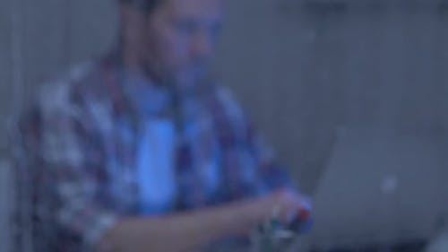 Thoughtful Male Freelance Writer Having No Ideas, Working on Laptop on Rainy Day