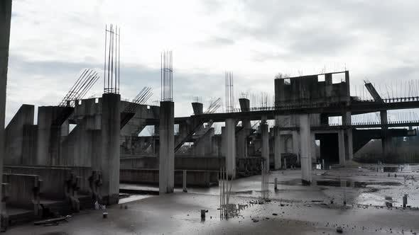Concrete columns, girders and beams reinforced with steel bars on abandoned construction site