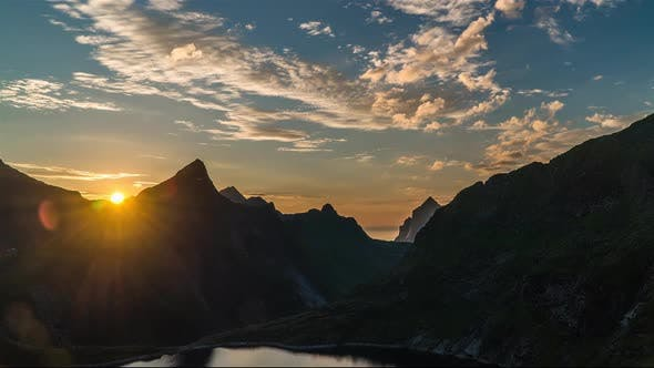 Thumbnail for Timelapse of Sunset and Floating Clouds Above Norway Islands and Mountains