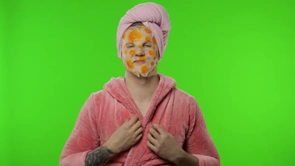 Thumbnail for Transsexual Man in Bathrobe with Face Mask Looking at Camera, Smiling