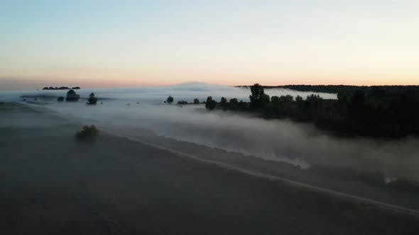 Thumbnail for Foggy Sunrise Over the Lake in Spring. Aerial View