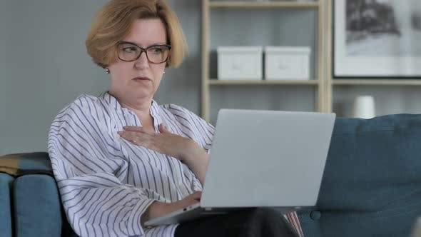 Shocked, Stunned Old Woman Wondering and Working on Laptop