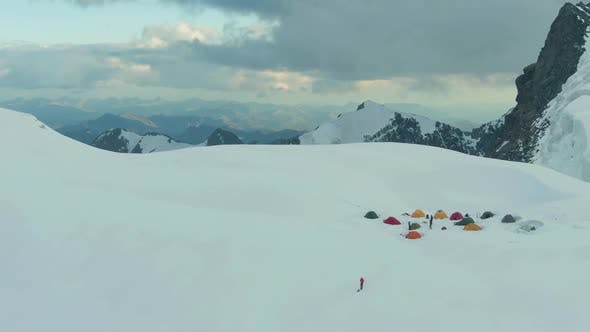Thumbnail for Camping and Snowy Mountains in European Alps at Sunset. Aerial View