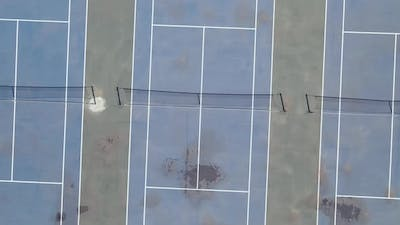 Drone Panning Away From Tennis Courts