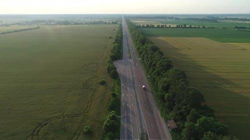Highway Passes Between The Green Fields