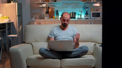 Tired Man in Pajams Browsing on Internet Lifestyle Information