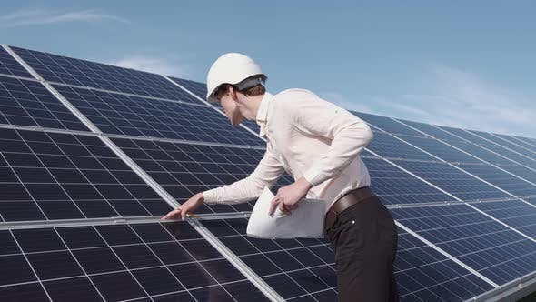 Thumbnail for A Man Is Checking the Solar Power Panel at the Plant