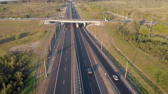 Thumbnail for Aerial View. Interchange on the Intercity Highway. Cars and Trucks Travel in Different Directions