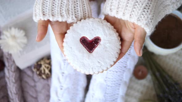Thumbnail for Softness, Comfort, Holiday, Feast, Coziness Concept. Cookie With Heart In Hands.