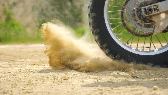 Close Up Wheel of Powerful Off-road Motorcycle Starting Movement. Motocross Bike Starts Move. Dry