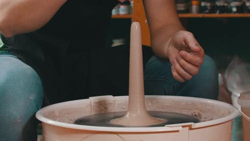 Man's Hands Sculpting a Figure