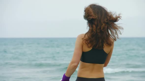 Thumbnail for Happy Young Woman Stops to Drink Water After Morning Run, Looking Into Camera
