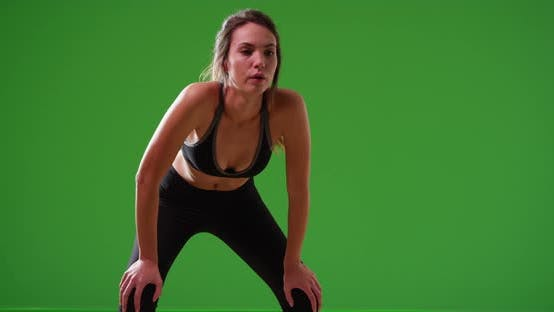 Thumbnail for Young Caucasian woman doing breathing exercises after jog on green screen