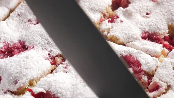 Thumbnail for Tasty cherry cake cutting  on smaller pieces 4K2160p UHD footage - Cherry sponge cake powdered with