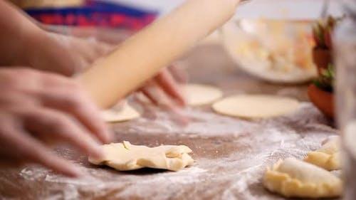 Step by step. Rolling dough for home made empanadas.