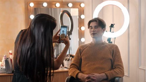 Make Up Artist Taking Photos of Male Model with Makeup on - Nude Makeup with Bold Dark Nude Lips