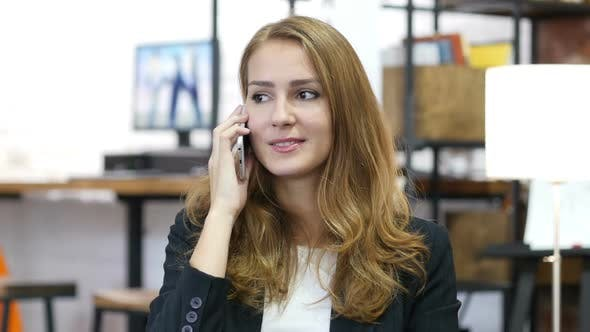 Thumbnail for Portrait of Working Girl, Attending Phone Call at Work