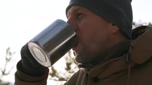 Man Drinking Steaming Hot Beverage Outdoors