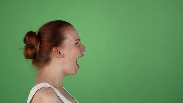 Thumbnail for Young Woman Screaming on Green Chromakey Background