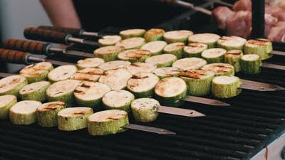 Zucchini Grilled on Skewers on the Open Barbecue at Food Court Vegan Shashlik