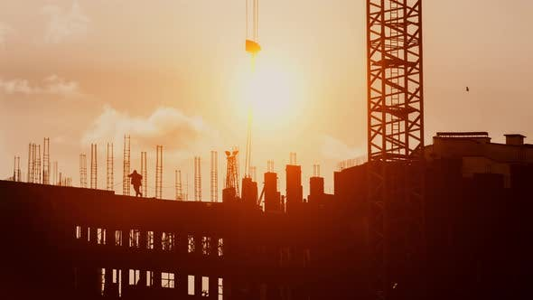 Cover Image for Crane Elevate Steel Structures Weight on Construction Working Sunset Golden Hour