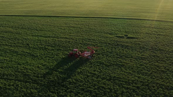 Thumbnail for Tractor Shrinks Its Sprayer After Work