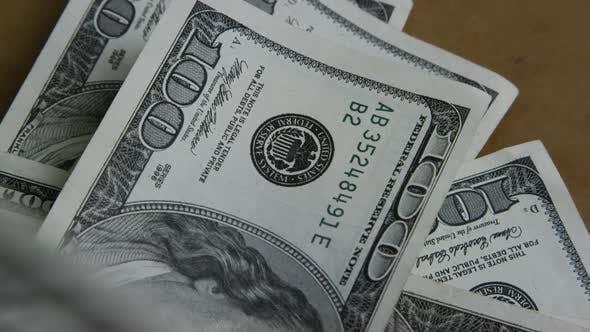 Rotating stock footage shot of $100 bills - MONEY 0153