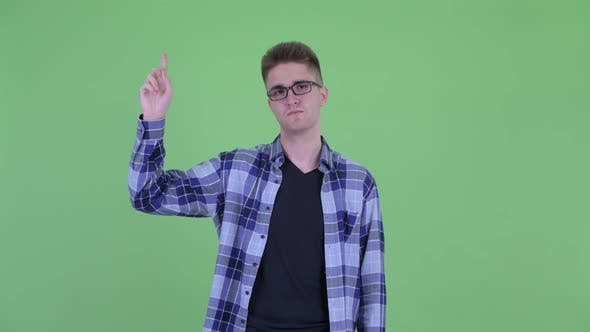 Thumbnail for Happy Young Handsome Hipster Man Pointing Up